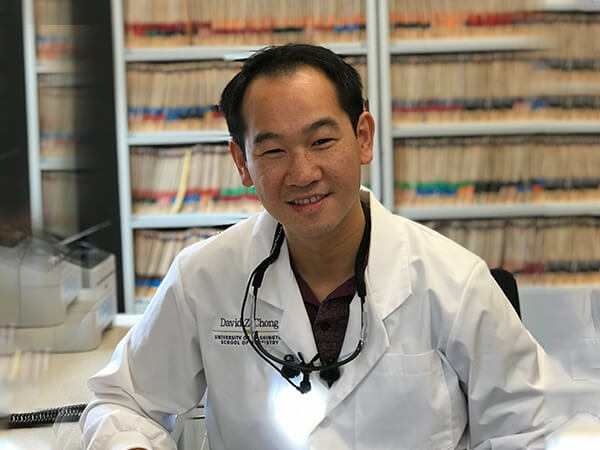 One of our lead Bonney Lake dentists, Dr. David Chong, smiling at the office